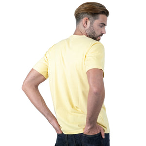 Light Yellow T-Shirt on Model Backward Facing at 3/4 Angle