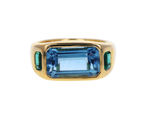 Blue Topaz and Emerald Three Stone Ring