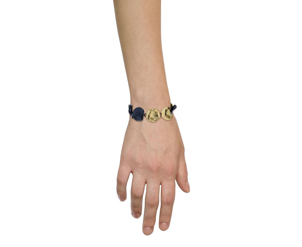 Floating in the Dark Disc Bracelet - TWISTonline