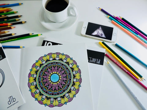 photo of coffee, coloring pencils, mandala on a table