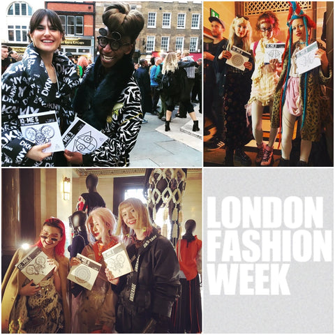 Stylists and fashionistas holding IQ-ME by Johny Dar colouring books at London Fashion Week