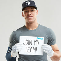 A photo of Aaron Judge holding a sign reading,