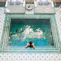 Aerial shot of a woman resting in the pool at Riad Yasmine