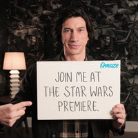 Adam Driver points to a sign reading