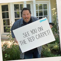 Greg Grunberg holds a sign that reads