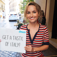 Giada de Laurentiis holding a sign in Italy reading,