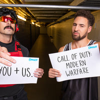 Dr Disrespect and Klay Thompson holding signs reading,