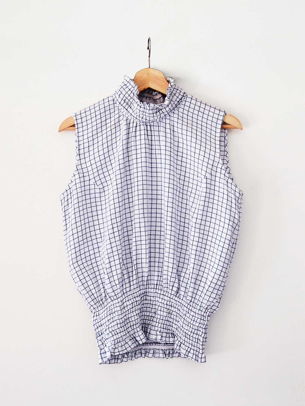 white an blue checked Sleeveless top with gathered collar and waist, designed by Khumanthem Atelier