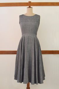 Retro circle dress with pockets featuring zipper at the back