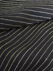 Close up view of the material of Front view of hanger shoot of Black and gold stripe tiered jacket designed by Khumanthem Atelier
