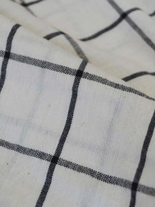 Close view of the material of checkered tops, designed by Khumanthem Atelier