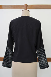 Close up back view of Handwoven Metallic weave sleeves coat for women, designed by Khumanthem Atelier