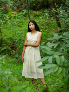 model wearing Handwoven Tie-up front Cotton Tunic Dress, designed by Khumanthem Atelier