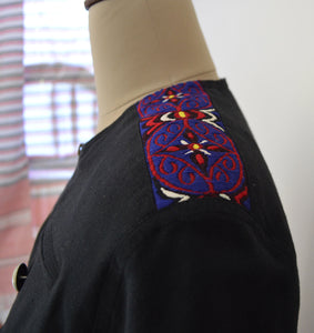 Close front view of Close view of the traditional Meitei patch work on the shoulder of Handwoven Military Style Cape coat, designed by Khumanthem