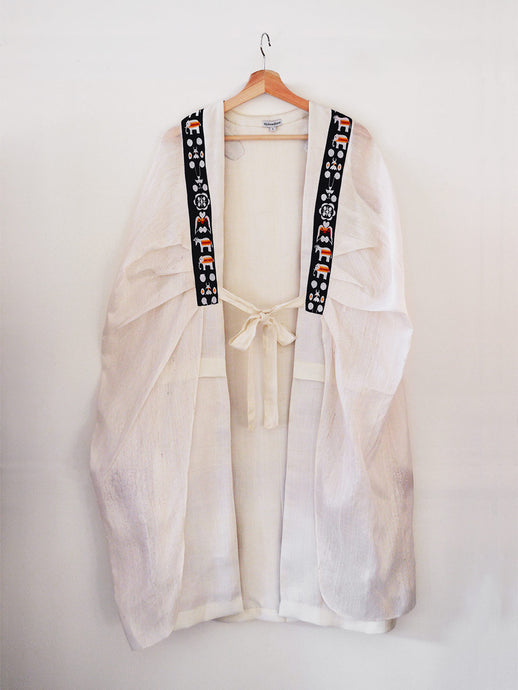 Unbleached white colour Cocoon coat with tie-up front (traditional Shamee-Lanmee Motif of Meitei), designed by Khumanthem Atelier