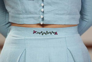 Close up view of the Handwoven cotton Pleated maxi skirt with floral embroidery, designed by Khumanthem Atelier