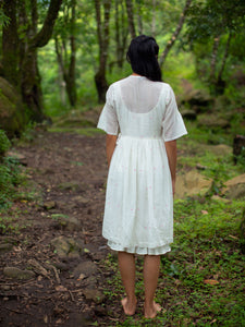 Model wearing Handwoven Gathered waist cotton dress, designed by Khumanthem Atelier, back view