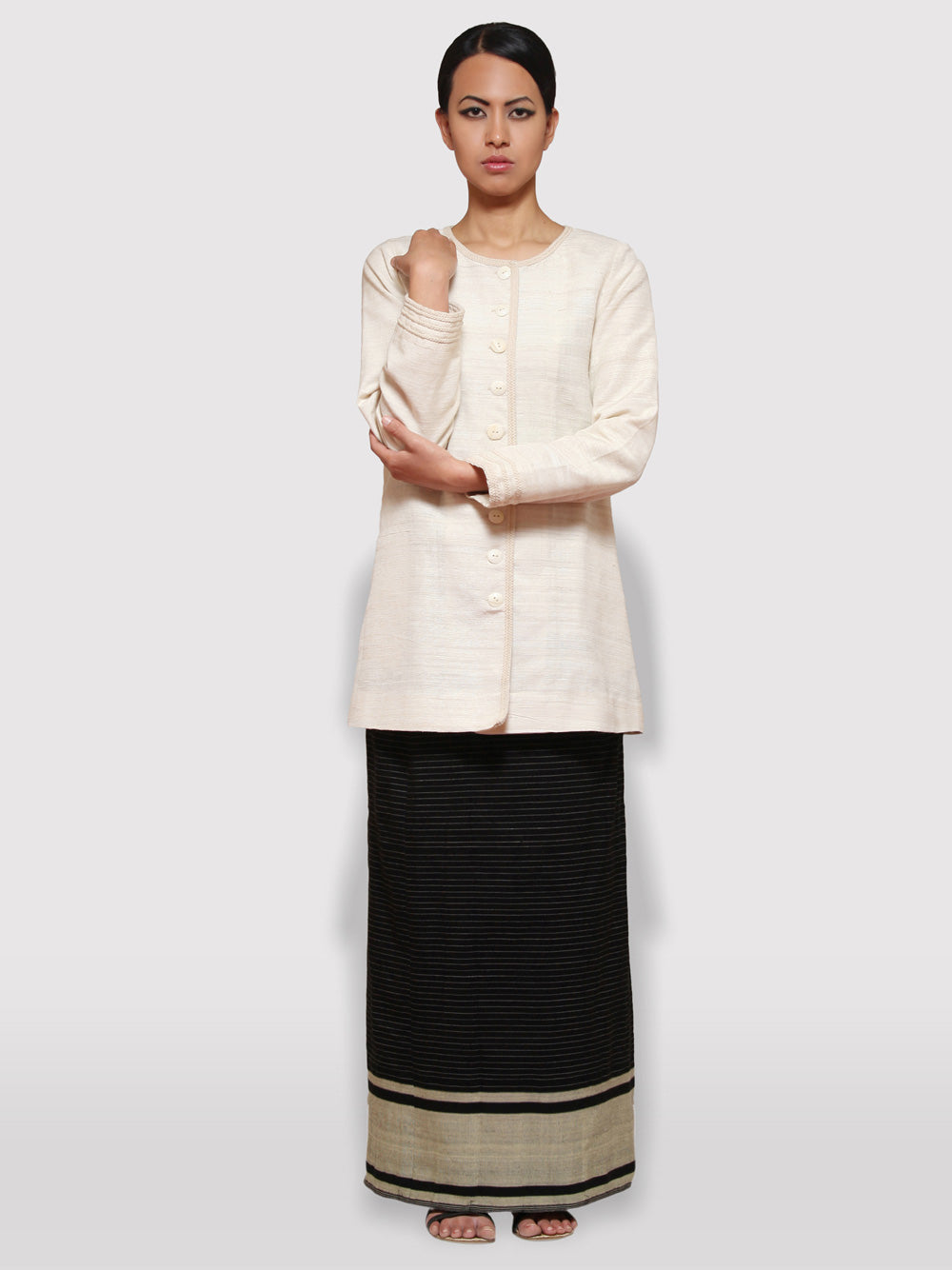 Handwoven Pinstripe wrap-around skirt inspired by traditional Meitei attire designed by Khumanthem Atelier