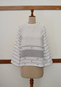 Close up front view of hanger shoot of Handwoven cotton full sleeves top with extra weft designed by Khumanthem Atelier