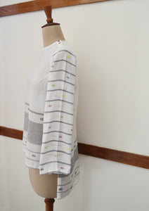 Close up side view of hanger shoot of Handwoven cotton full sleeves top with extra weft designed by Khumanthem Atelier