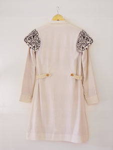 Back view of Handwoven Embroidered trench coat, unbleached white colour, designed by Khumanthem Atelier
