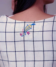 Load image into Gallery viewer, Close up view of hand embroidered checked tunic dress designed by Khumanthem Atelier