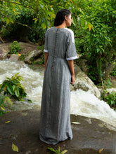 Load image into Gallery viewer, Model wearing Drawstring Cotton Maxi Dress with Pockets, designed by Khumanthem Atelier, back view