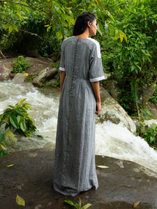 Model wearing Drawstring Cotton Maxi Dress with Pockets, designed by Khumanthem Atelier, back view