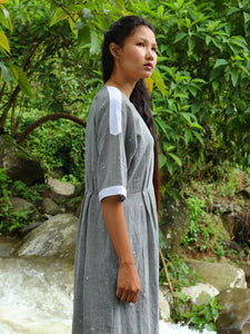 Model wearing Drawstring Cotton Maxi Dress with Pockets, designed by Khumanthem Atelier, side view