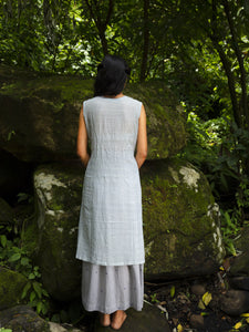 Model wearing Handwoven Sleeveless Cotton Tunic with gathered front Dress, designed by Khumanthem Atelier, back view