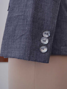close up of the details on the sleeves of the Handwoven Single button coat with cropped trousers, designed by Khumanthem Atelier