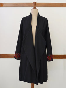 "Full front view of the Hand embroidered long coat ""mapan naiba motif"", designed by Khumanthem Atelier"