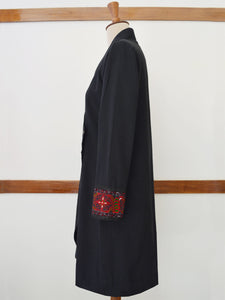 "Full side view of the Hand embroidered long coat ""mapan naiba motif"", designed by Khumanthem Atelier"