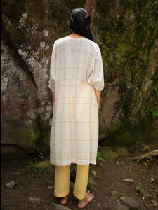 Model wearing Handwoven Dolman sleeves cotton tunic, designed by Khumanthem Atelier, Back view