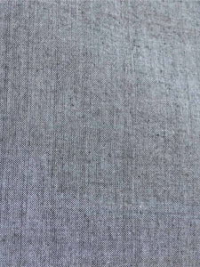 Close up view of the material of Handwoven cotton High low hem straight top, full sleeves designed by Khumanthem Atelier