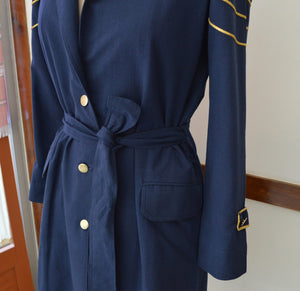 close up view of the belted details on the trench coat designed by Khumanthem Atelier