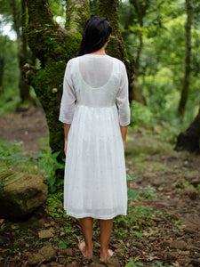 model wearing Handwoven Gathered hem quarter sleeves cotton dress, designed by Khumanthem Atelier, Back view