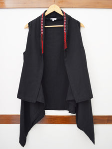 Sleeveless shrug with braided detail on collar
