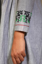 "Load image into Gallery viewer, Tunic with tie up and detailed embroidery of traditional ""sha-nga"" motif on sleeves."