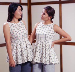 Models posing with Handwoven cotton Checked Top With Flared Waist, designed by Khumanthem Atelier