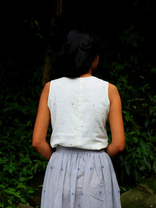 Back view of model wearing Handwoven Back hooks sleeveless top, designed by Khumanthem Atelie