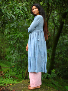 Handwoven cotton dress with white dots featuring a gathered waist and side opening