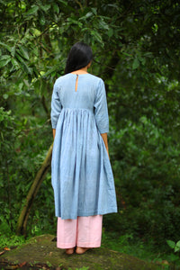 Back view of model wearing of Handwoven Gathered waist cotton dress, designed by Khumanthem Atelier