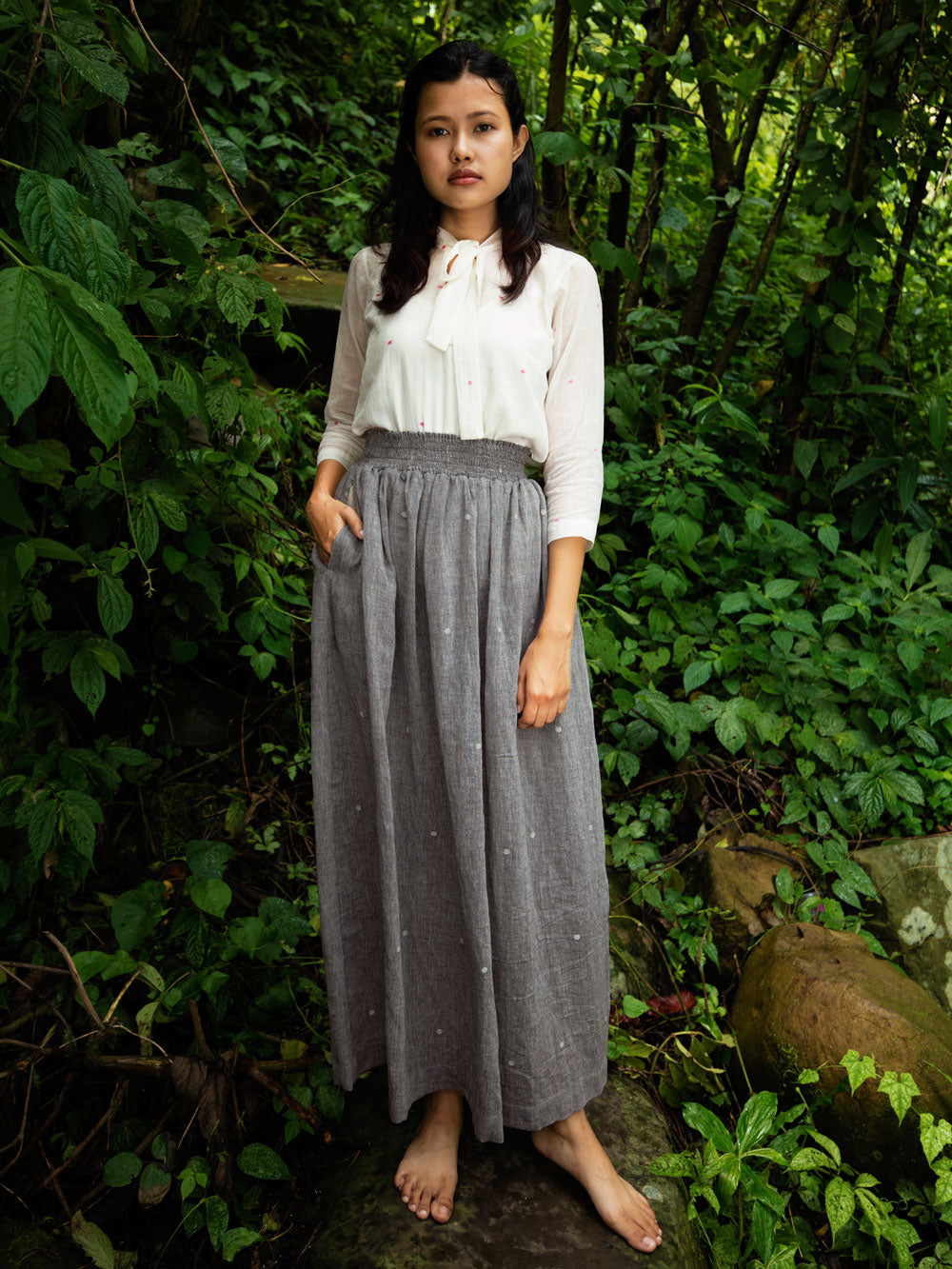 Handwoven cotton skirt with white dots featuring elasticated waist & deep pockets