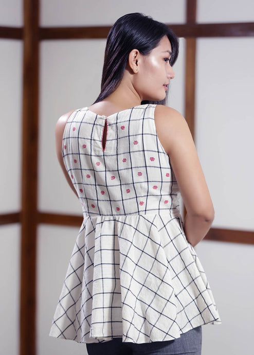 Checkered top with traditional embroidery featuring traditional