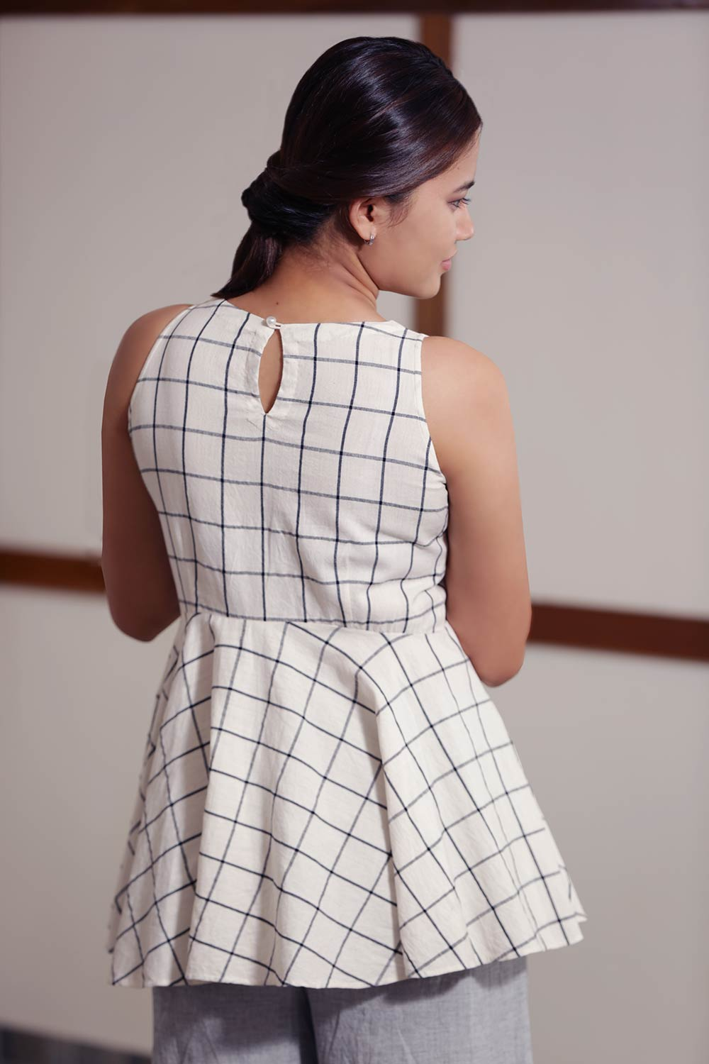 Handwoven cotton Checked Top With Flared Waist, designed by Khumanthem Atelier