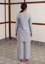 Load image into Gallery viewer, Back view of Full view of model posing with Handwoven cotton High low hem straight top, full sleeves designed by Khumanthem Atelier