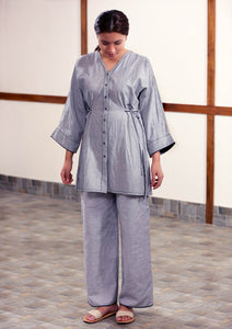 Grey kimono sleeve tunic featuring hand embroidered running stitch in black and tie-ups on the sides.