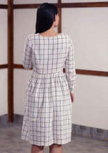Load image into Gallery viewer, Back view of Checked peasant dress with running stitch design, designed by Khumanthem Atelier