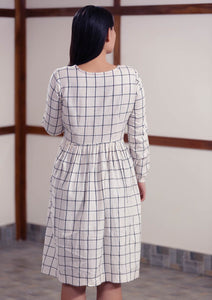 Back view of Checked peasant dress with running stitch design, designed by Khumanthem Atelier